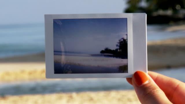stockvideo's en b-roll-footage met beach polaroid - polaroid