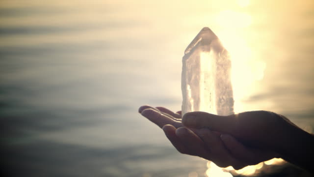 Beach relaxation. Holding healing crystals video