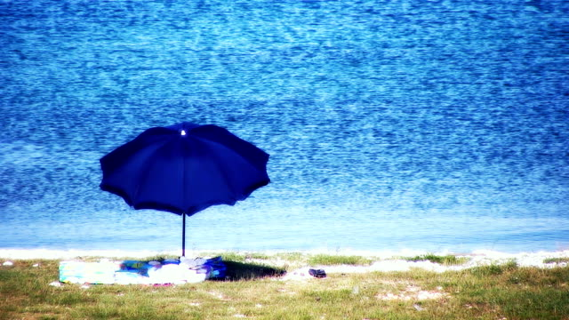 HD: Beach Scene With Parasol and Towels video