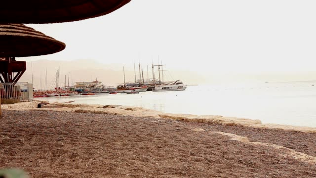 Beach, ships on the background of the beach, good weather, tropical climate video
