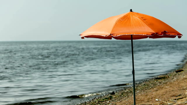 beach umbrella on an empty beach video
