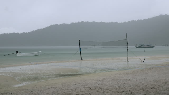 Beach volley net on a rainy day. video