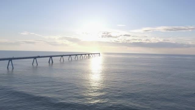 Beach with bridge - video