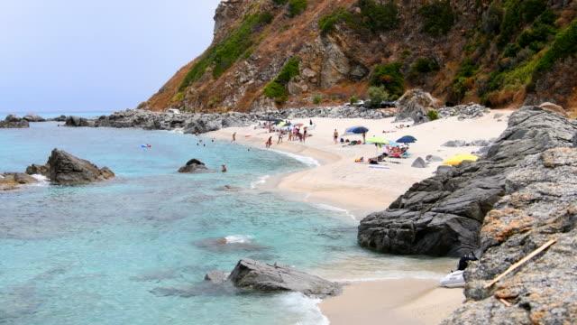 beach with crystal clear sea in the tropea area - video di tropea video stock e b–roll
