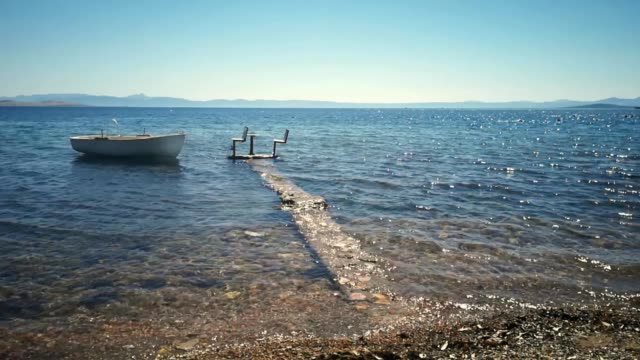Beached fishing boat moving on the sea shore Beached fishing boat moving on the sea shore provence alpes cote d'azur stock videos & royalty-free footage