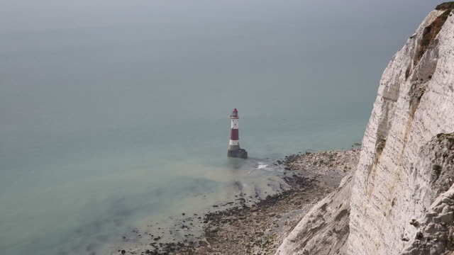 beachy head lighthouse east sussex england uk near eastbourne and east of the seven sisters chalk cliffs - south downs video stock e b–roll