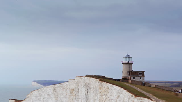 beachy head with seven sisters in distance - drone shot - south downs video stock e b–roll