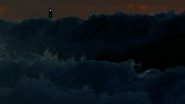 beacon light through storm waves