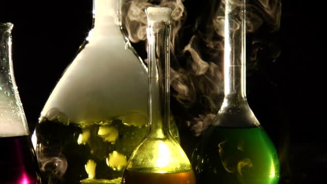 Beakers - Tilt Up Slow Motion Slow motion tilt up on science beakers. beaker stock videos & royalty-free footage