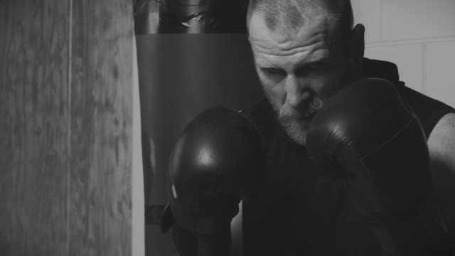 Bearded Aggressive Redhead Adult Man Boxer wearing boxing gloves