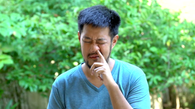 Bearded Asian man pick his nose Bearded Asian man pick his nose, enthusiastically middle finger stock videos & royalty-free footage