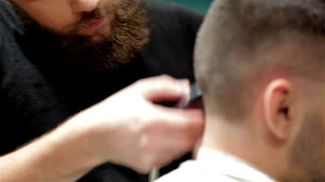 Bearded brutal man in a barber shop video