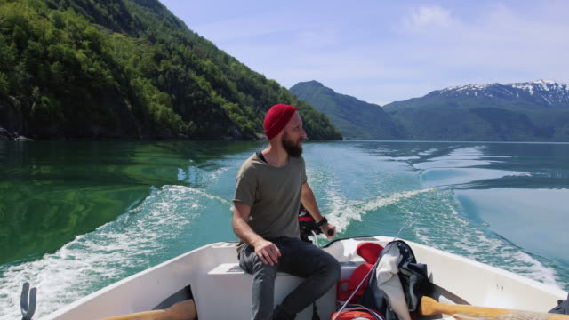 Bearded fisherman on a small fishing boat: sailing in a fjord in Norway Fisherman on a small fishing boat: sailing in a fjord in Norway one man only stock videos & royalty-free footage