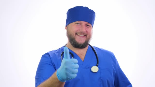 Bearded smiling male medical worker showing thumbs up sign