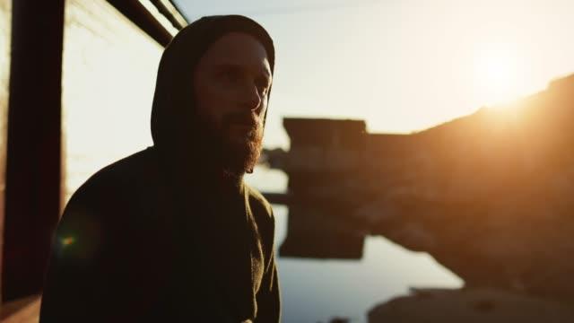 Bearded viking man portrait: by a fjord