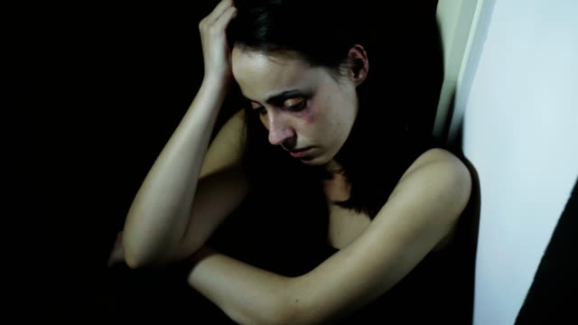 beaten young woman - violenza sulle donne video stock e b–roll