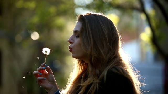 Beatiful Girl Blow a Dandelion - Slow Motion