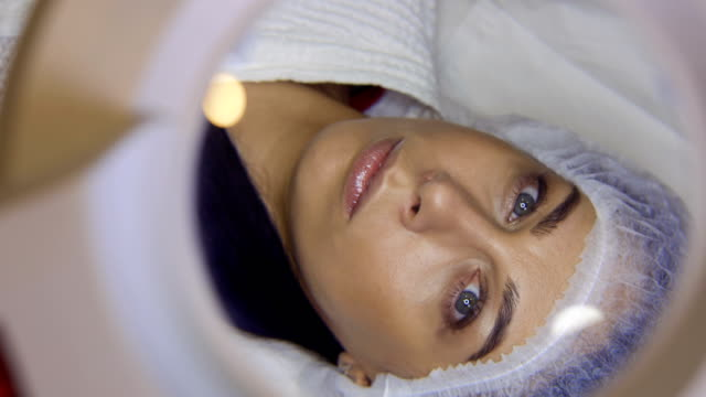 Beautician applies eye patch preparing client to procedure of eyelash extension video