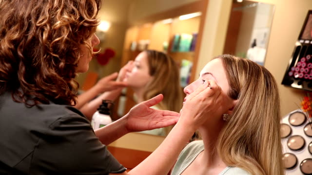 Beautician Applying Eyeliner video