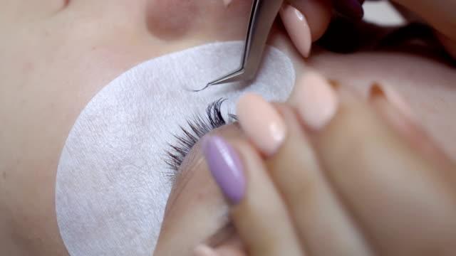 Beautician makes eyelash extension video
