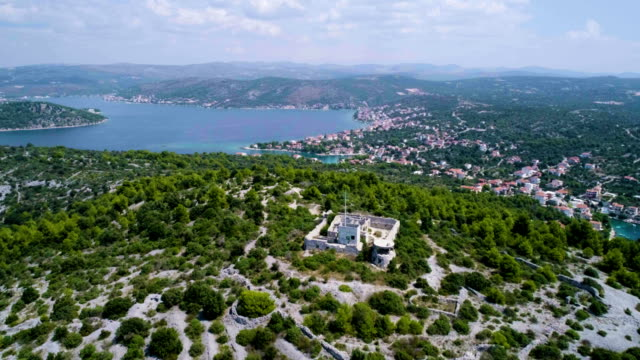 Beautiful 4K aerial video of Dalmatia, Croatia, Europe Beautiful 4K aerial video of Dalmatia, Croatia, Europe. Nice nature and landscape on warm sunny summer day at Adriatic Sea and coast. Lovely seascape and outdoors shoot with drone from above in sky. coastal feature stock videos & royalty-free footage