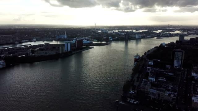 vacker 4 k flygfoto över rotterdam kanalen och ett fartyg under solnedgången - drone amsterdam bildbanksvideor och videomaterial från bakom kulisserna