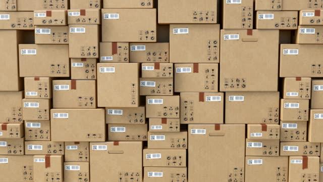 美しい抽象的な段ボール箱の壁無限。パーセルのバーコードとqrコード。配達、貯蔵および輸送の概念のための箱のループ3dアニメーション。 - 壁点の映像素材/bロール