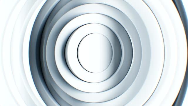 Schöne abstrakte weiße Kreise winken nahtlose Hintergrund. Looped 3d Animation der Lautstärke saubere Ringe drehen Muster. Business- und Technologiekonzept. – Video