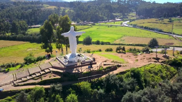 Beautiful Aerial shot of White Christ and forrest. Latin America. Beautiful Aerial shot of White Christ and forrest. Latin America. Statue is also called: Cristo Blanco, white christ, christ the redeemer, christo redentor. cristo redentor stock videos & royalty-free footage