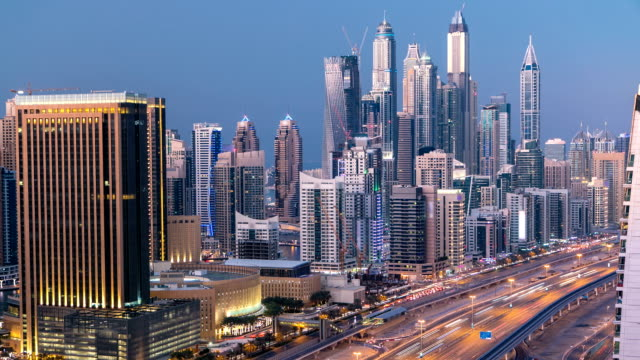 Beautiful aerial top view day to night timelapse of Dubai Marina and JLT in Dubai, UAE video