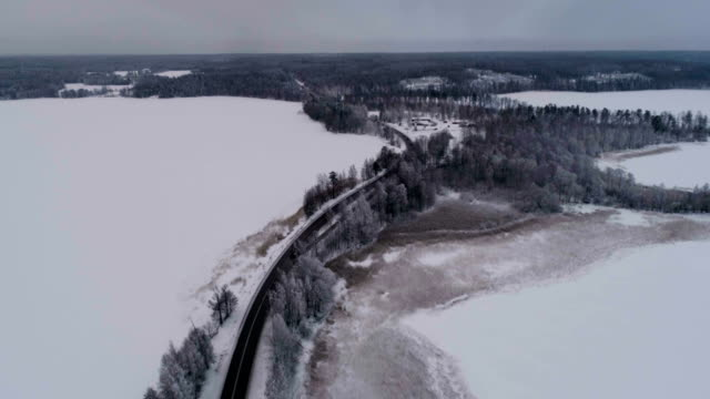 Beautiful aerial video of frozen ice lake and road in Sweden video