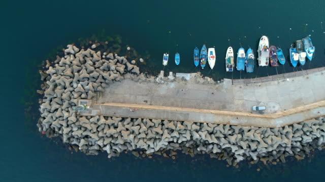 vídeos de stock e filmes b-roll de beautiful aerial view of anchored fisherman boats on the quay - fishman