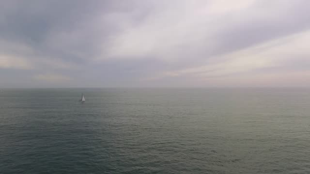 Beautiful Aerial view of ocean and a sailboat video