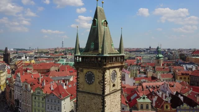 beautiful aerial view of the prague clock tower in the city town square. - church architecture stock videos & royalty-free footage