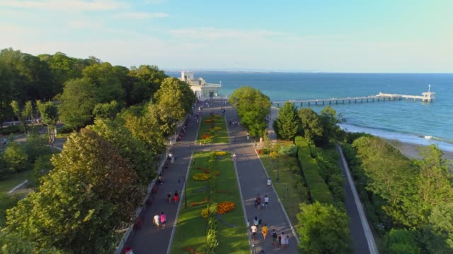 Beautiful aerial view of the sea garden in Burgas, Bulgaria Beautiful aerial view of the sea garden in Burgas, Bulgaria. The scene is situated outdoors near sunset in Burgas, Bulgaria on the Black Sea shores.  The video is shot with DJI Phantom 4 Pro drone. natural parkland stock videos & royalty-free footage