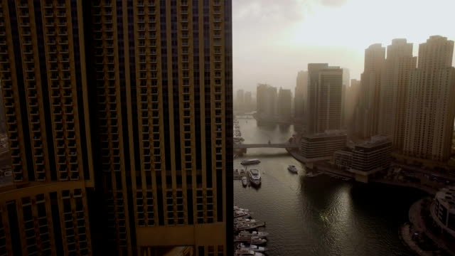 beautiful aerial view on bay with yachts and embankment among the skyscrapers in Dubai, UAE video