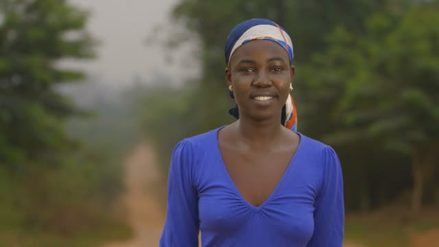 Beautiful Africa, portrait of a young African woman smiling modestly video