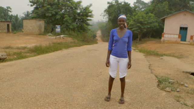 Beautiful Africa, portrait of colorful woman with modest smile video