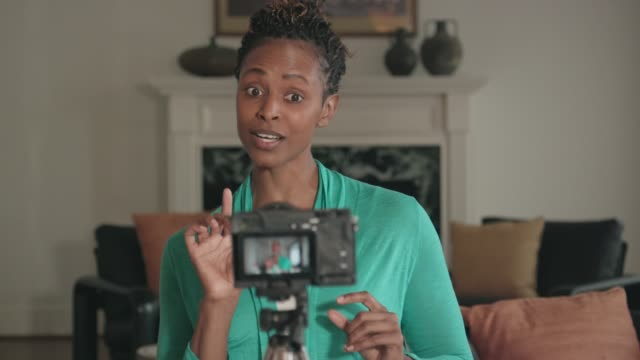 beautiful african-american vlogger recording a show - influencer filmów i materiałów b-roll