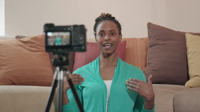beautiful african-american vlogger recording a show - influencer стоковые видео и кадры b-roll