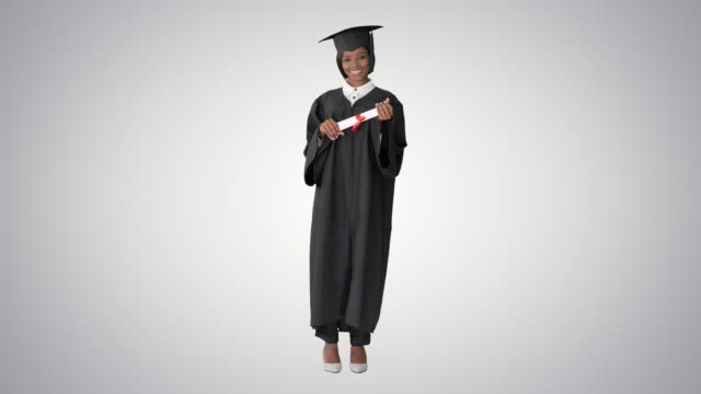 Beautiful afro american young woman graduate smiling on gradient background