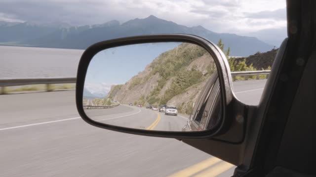 UHD 4K: Beautiful Alaskan landscape in the rearview mirror of a vehicle video