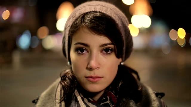 Beautiful and sad young woman looking at camera