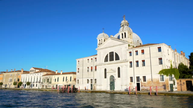 Beautiful antique hotel with cupola in Venice, view on building from boat video