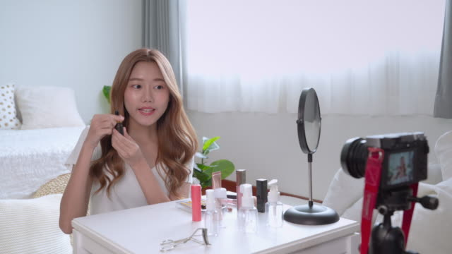 Beautiful Asian bloggers are online to review cosmetic products via social media.