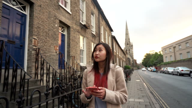 Beautiful Asian girl use mobile app map for explore city on vacation female, Caucasian, explore, app , smart phone, city uk map stock videos & royalty-free footage