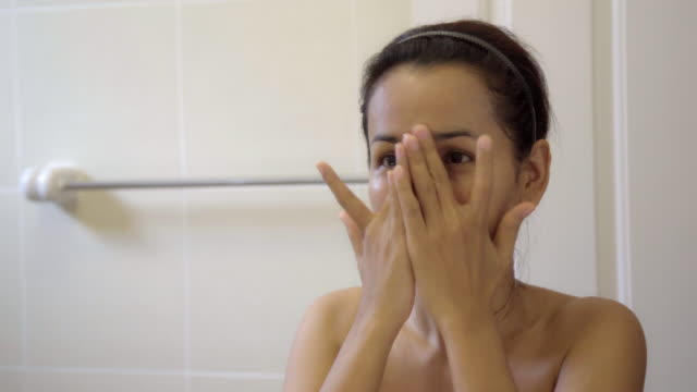 Video Beautiful Asian Woman Applying Cream and Massage Her Face with Herself.