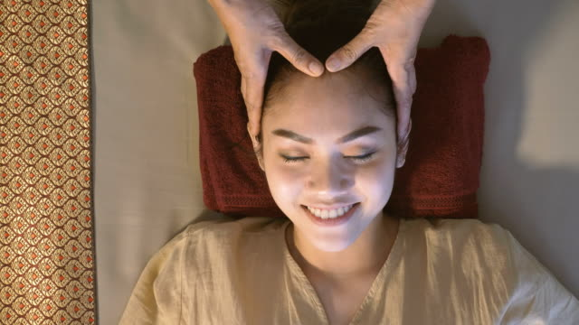 beautiful asian woman enjoying thai massage - alternative medicine stock videos and b-roll footage