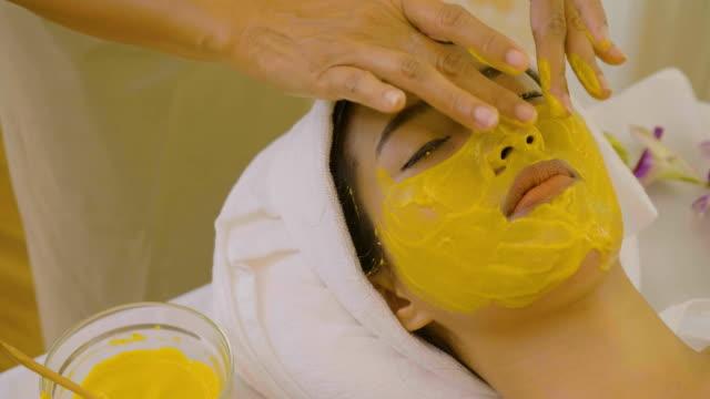 Beautiful Asian Woman having facial mask at beauty salon video