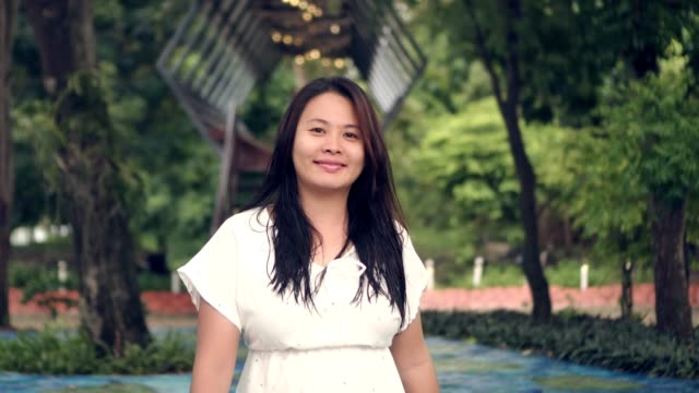 beautiful asian woman smiling walking green nature scene video